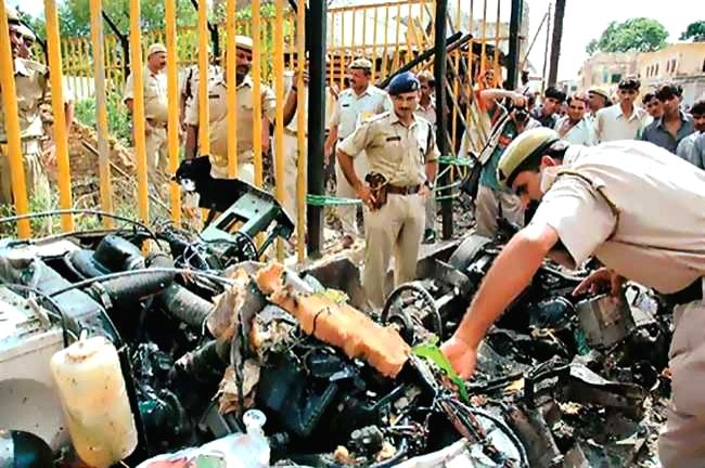 A policeman carries out investigation after five armed terrorists attacked the makeshift Ram temple in Ayodhya, Uttar Pradesh killing two civilians and injuring seven others on 5th July, 2005. (File Photo: IANS)