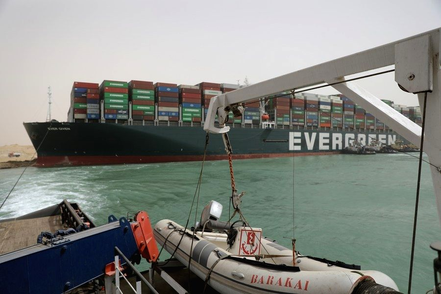A rescue vessel works at the site of a container ship trapped on the Suez Canal of Egypt on March 25, 2021. (Suez Canal Authority/Handout via Xinhua)