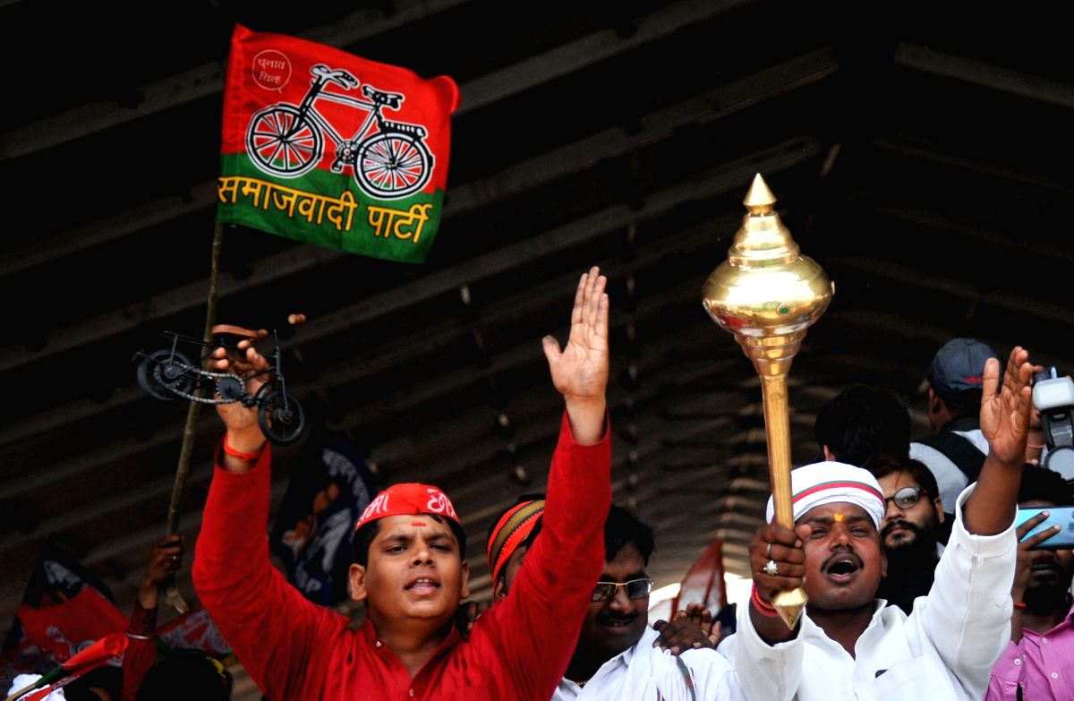 A Samajwadi Party (SP) worker with a BSP worker during a joint rally of SP, BSP and RLD  in Varanasi, Uttar Pradesh.