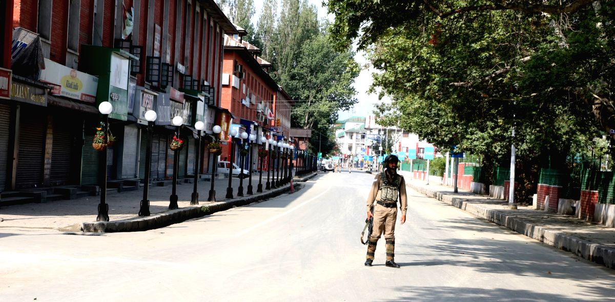 A soldiers mans a Srinagar street during a protest shutdown called by separatist leaders across the Kashmir Valley on Aug 15, 2017.