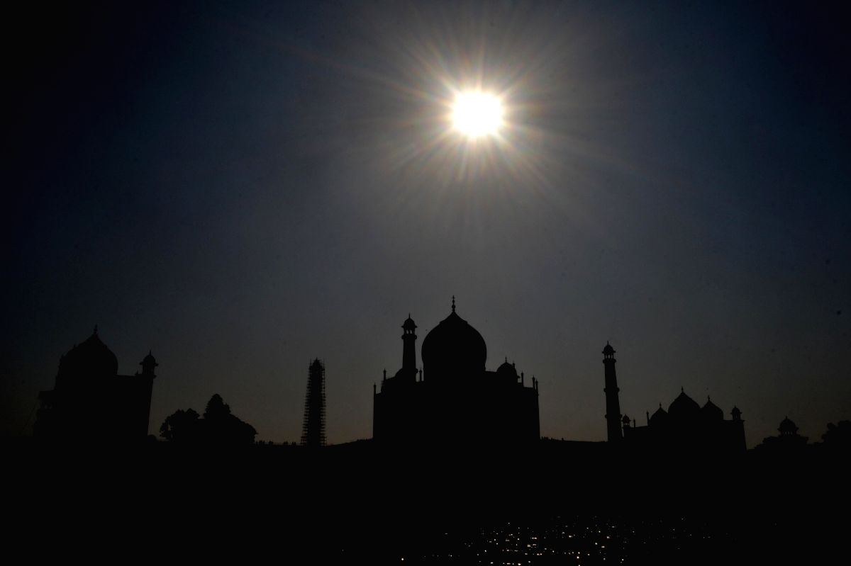 The moon shine over the Taj