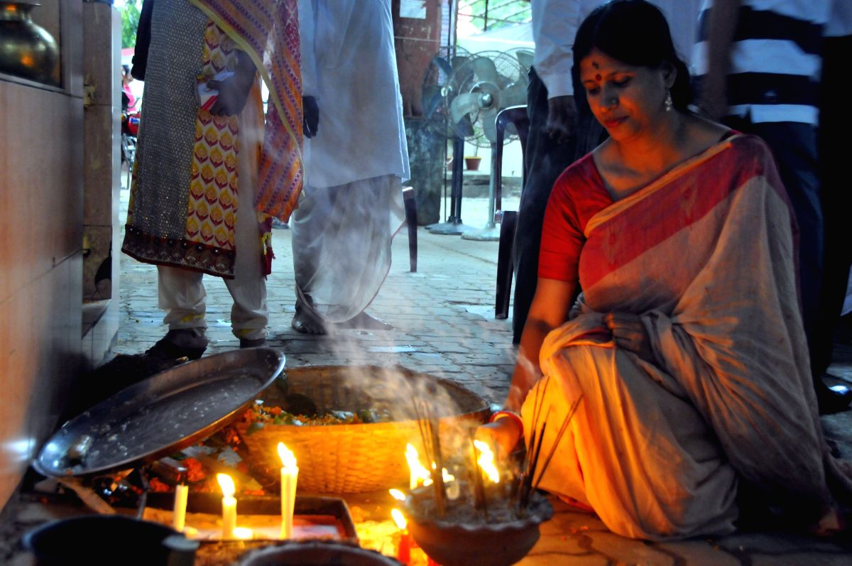 Woman offers prayers on the occasion of Durga Puja