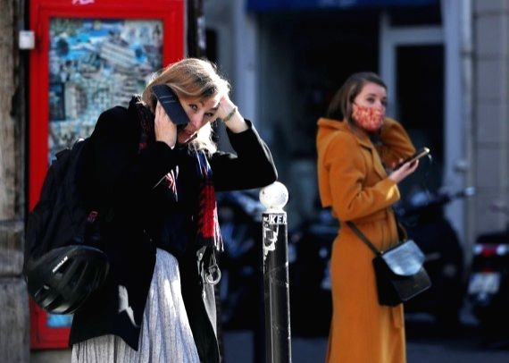 A woman talks on the phone in Paris, France, Nov. 9, 2020. (Xinhua/Gao Jing)