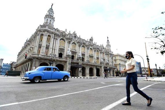 A woman wearing a face mask walks on a street in Havana, Cuba. (Photo by Joaquin Hernandez/Xinhua/IANS)