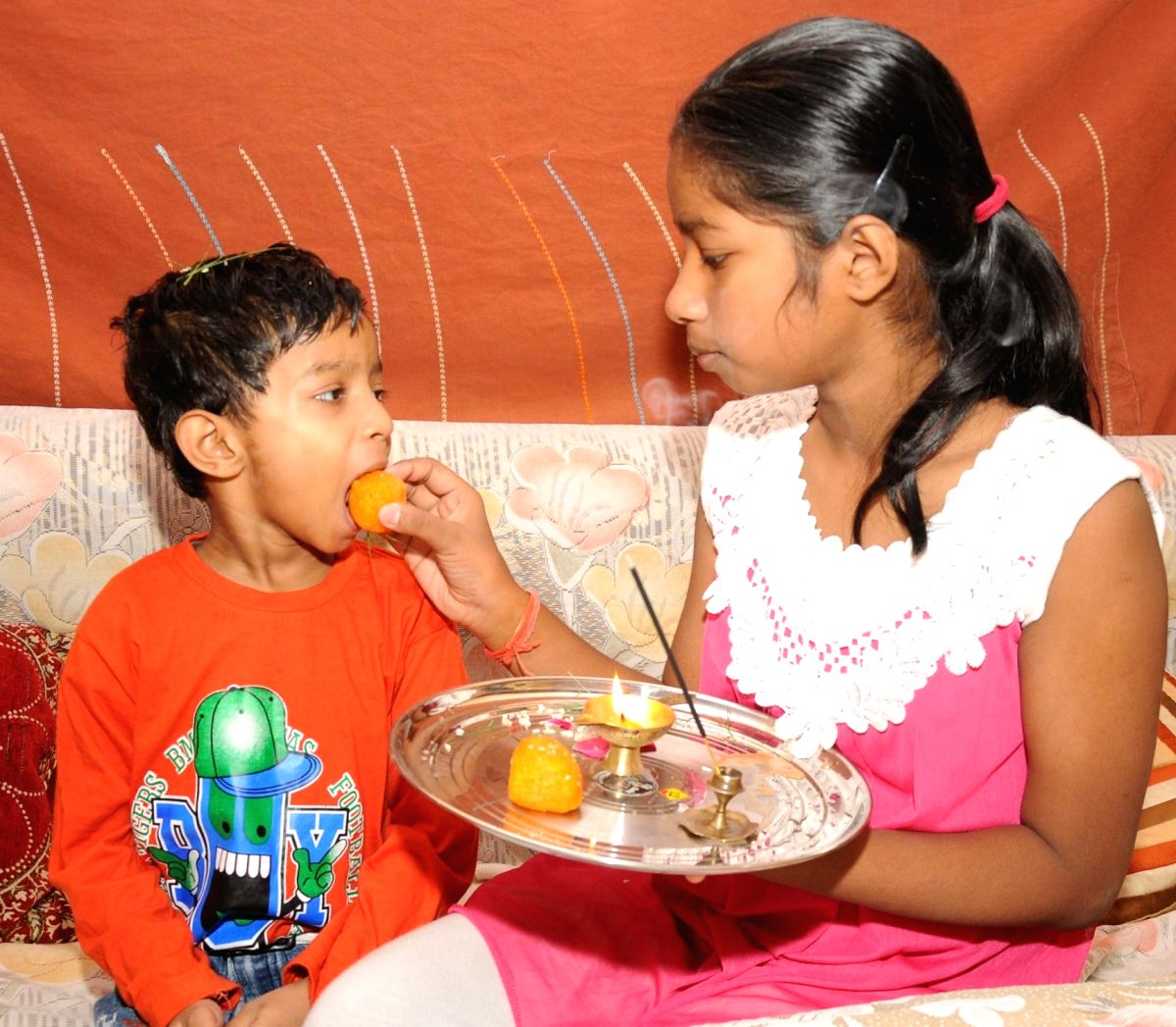 A young brother and sister celebrate 'Bhai Dooj'