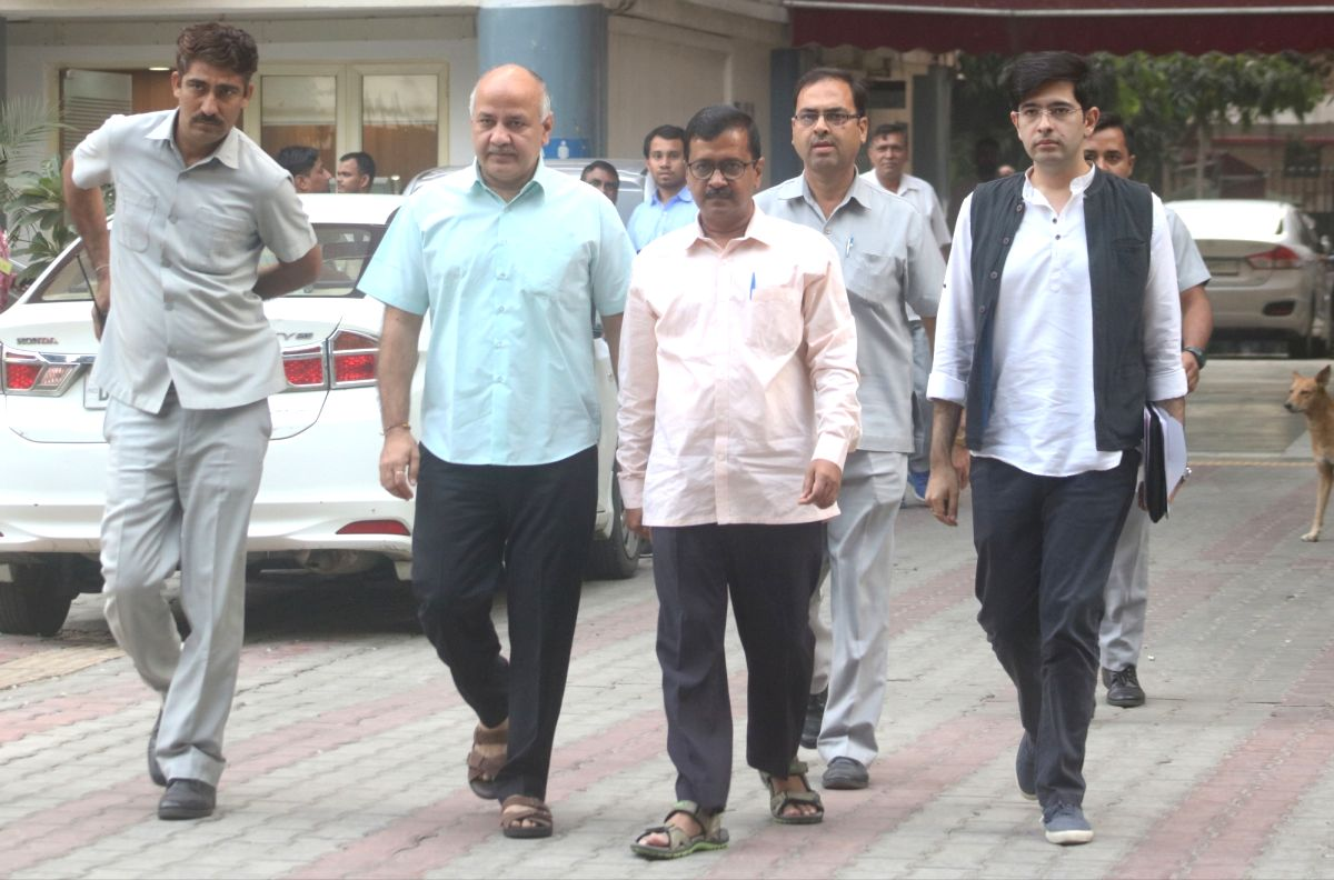 Aam Aadmi Party (AAP) leaders - Delhi Chief Minister Arvind Kejriwal, Deputy Chief Minister Manish Sisodia and spokesperson Raghav Chadda after meeting the Chief Election Commissioner