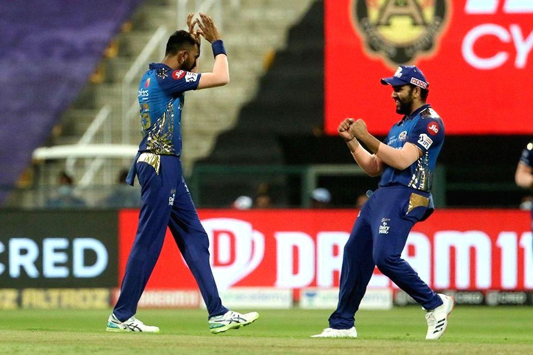 Abu Dhabi: Krunal Pandya of Mumbai Indians and Rohit Sharma captain of Mumbai Indians celebrates the wicket of Karun Nair of Kings XI Punjab during match 13 of season 13 of the Indian Premier League (IPL) between the Kings XI Punjab and the Mumbai In