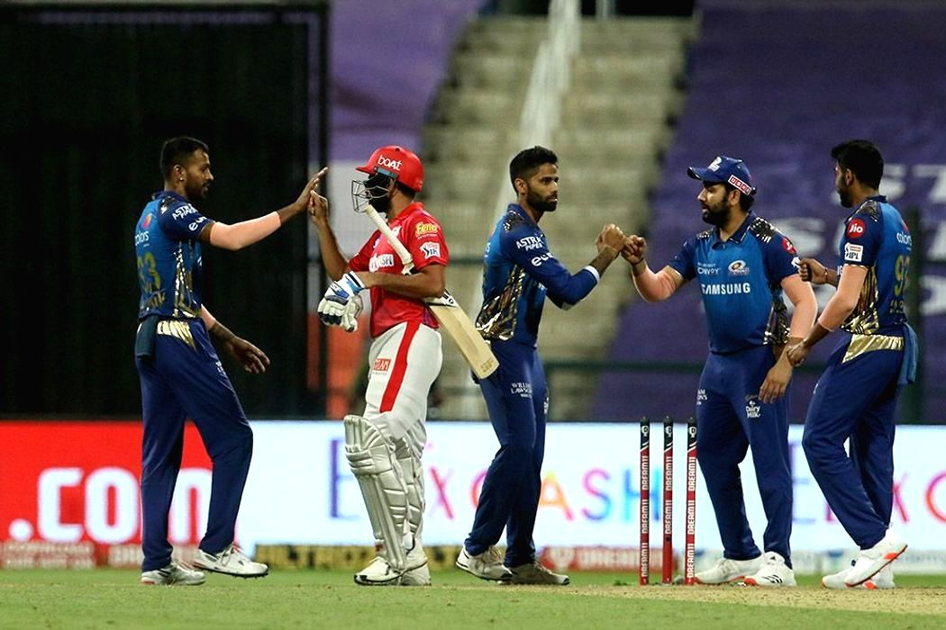 Abu Dhabi: Mumbai Indians and Kings X1 Punjab players shake hands after the match 13 of season 13 of the Indian Premier League (IPL) between the Kings XI Punjab and the Mumbai Indians at the Sheikh Zayed Stadium, Abu Dhabi in the United Arab Emirates