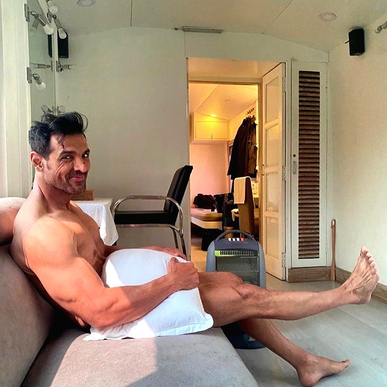 Actor John Abraham treated his fans to an interesting picture of himself on Instagram on Tuesday. Posing with just a pillow, the actor wrote about how he was waiting for his clothes to arrive!