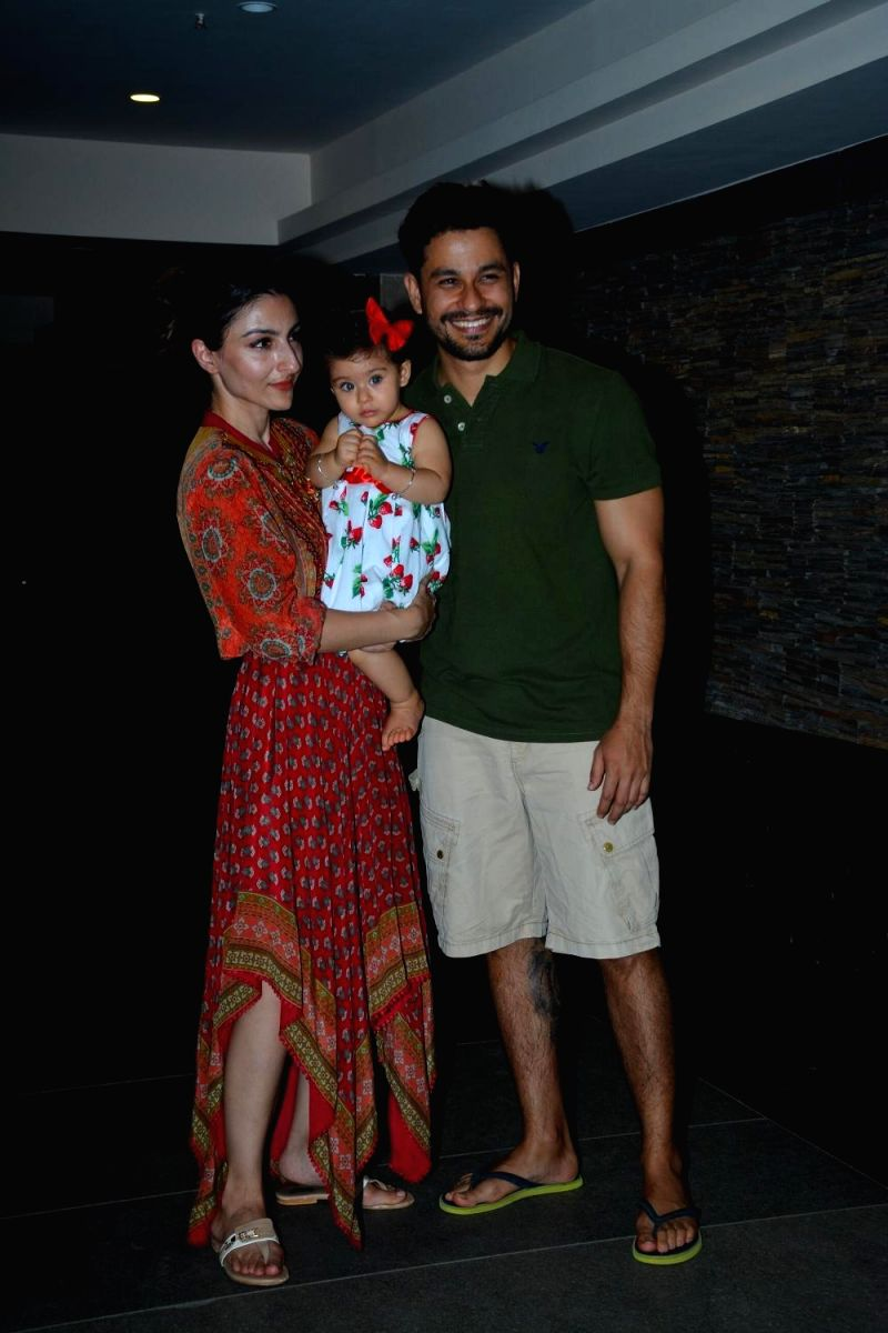 Proud parents Soha and Khunal at the birthday celebration of their daughter Inaya