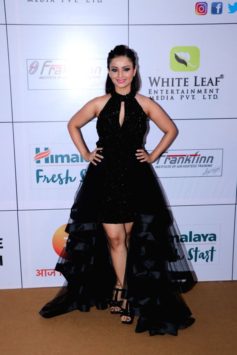 Adaa brings out the beauty of black. Love her hair and makeup too.