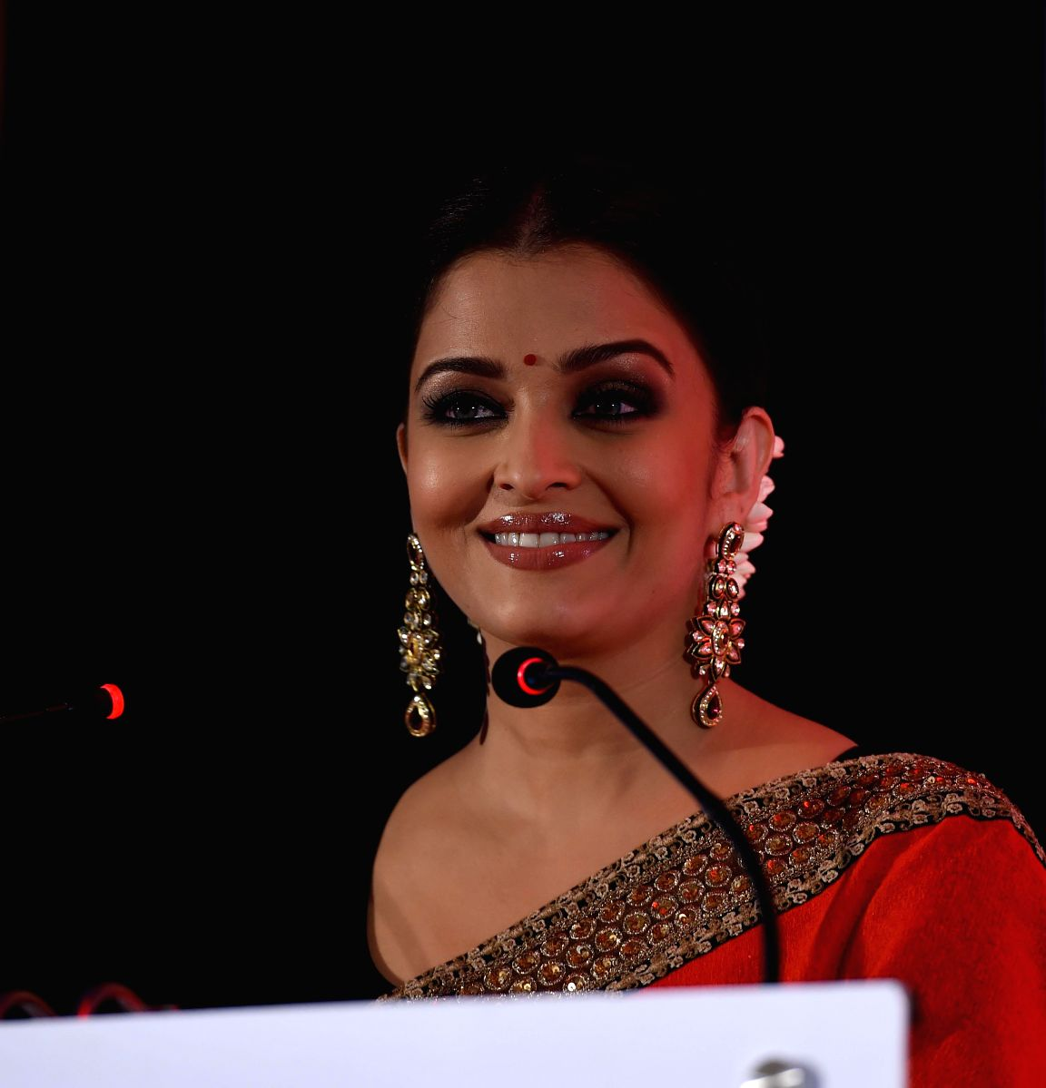 Aishwarya is the epitome of grace in this lovely red brocade saree
