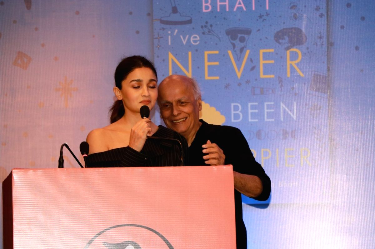 "Actress Alia Bhatt accompanied by her father Mahesh Bhatt, addresses at the launch of her sister Shaheen Bhatt's book ""I've Never Been (un)Happier"" in Mumbai on Dec 4, 2019."