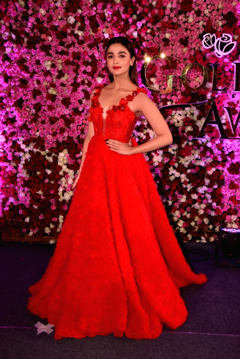 Alia looks lovely in this crimson gown with A-line flowery detail