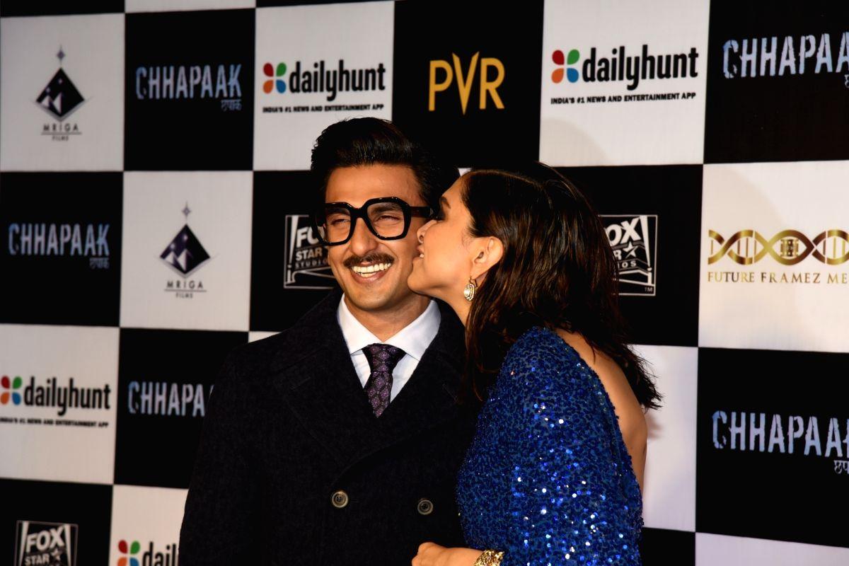 Actress Deepika Padukone kisses her actor husband Ranveer Singh