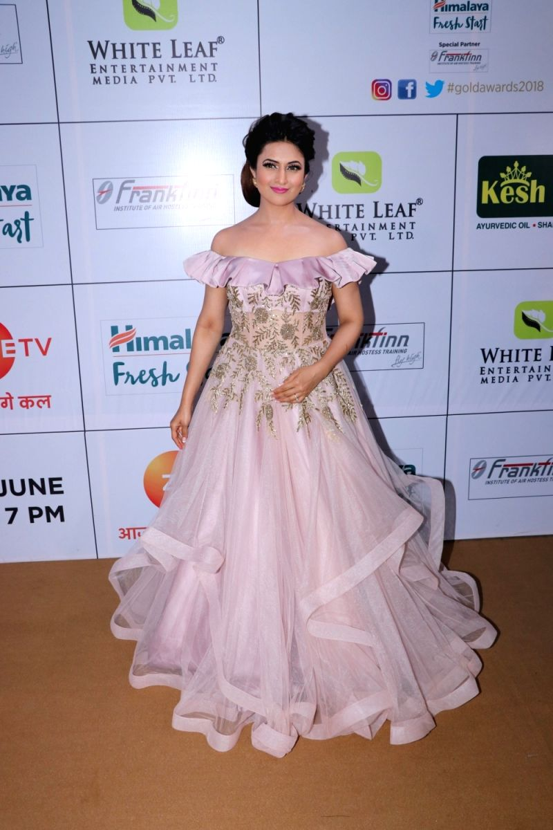Divyanka looks very much like a Disney princess in this attire. Special points for the lovely hair and makeup