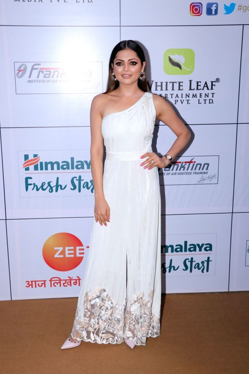 We love Drashti Dhami's look in this ivory jumpsuit with floral detailing. Bold eyes and nude makeup add a classic touch to complete her look