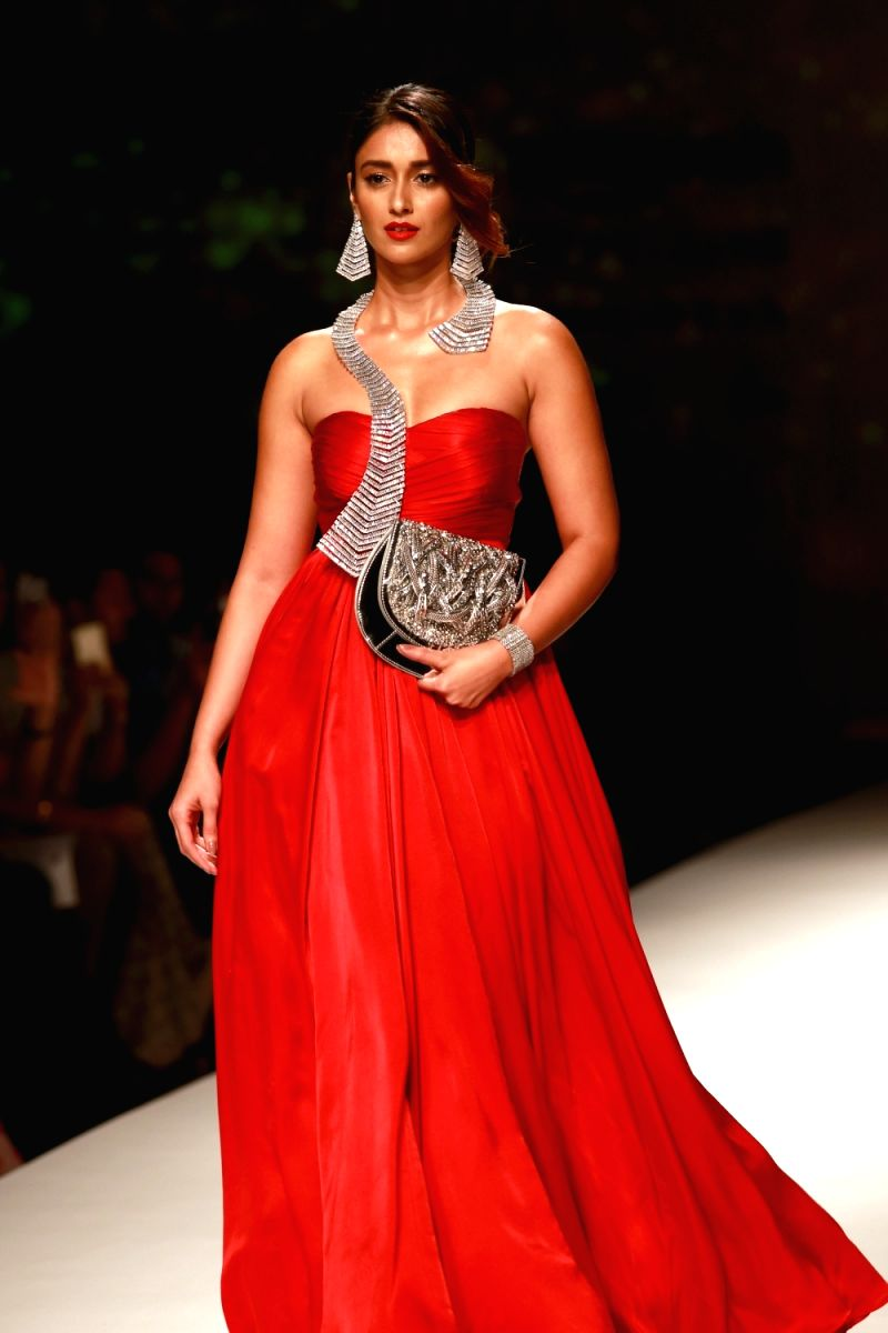 Ileana is a sight for sore eyes in this red gown