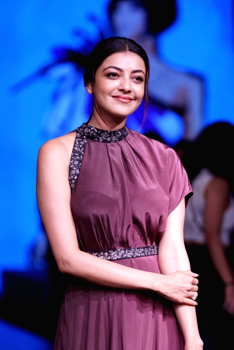 Kajal looked graceful in this plum colored satin gown with bead work