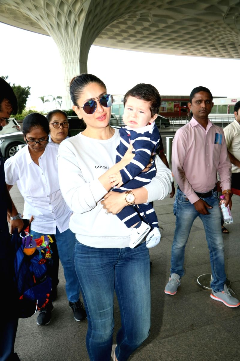 Yummy mommy Kareena Kapoor looks fantabulous in this blue jumper and jeans