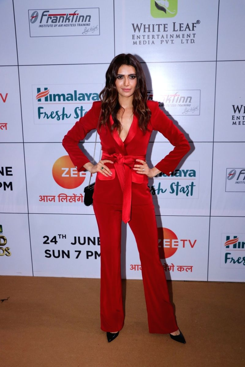 Karishma looks like a Bond girl in this red jumpsuit. Good job choosing the black handbag and stilettos