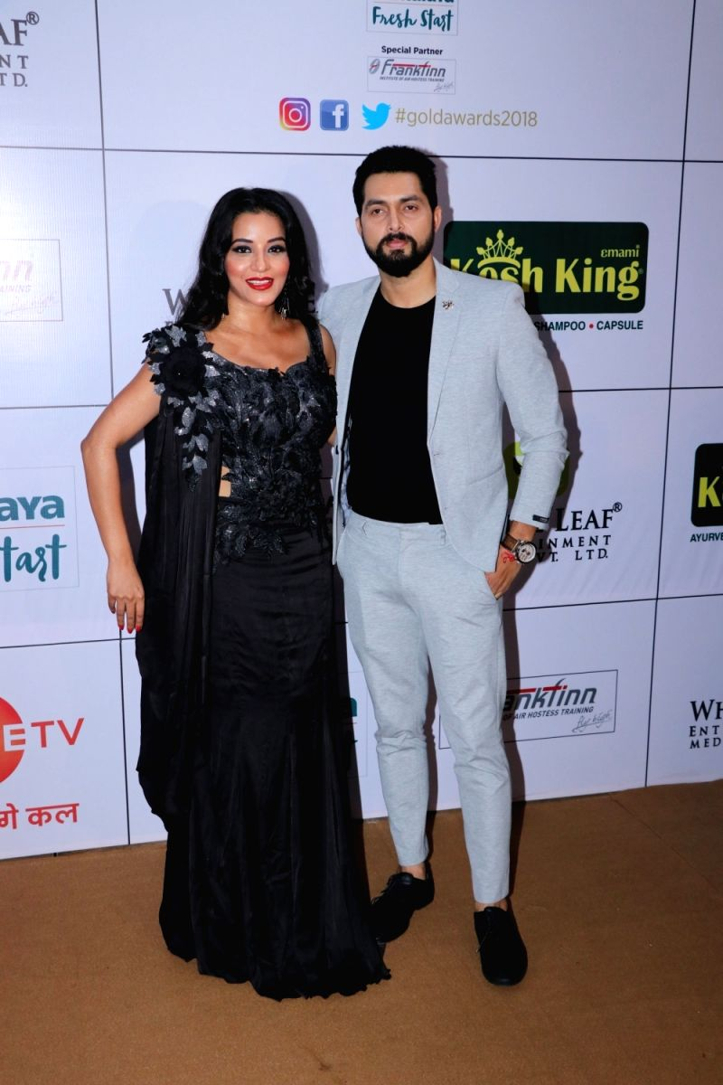 Monalisa and Vikrant Singh Rajpoot are all smiles as they pose for pictures