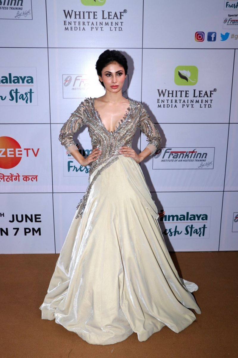 Mouni Roy looks absolutely breathtaking in this heavily embellished gown with plunging neckline