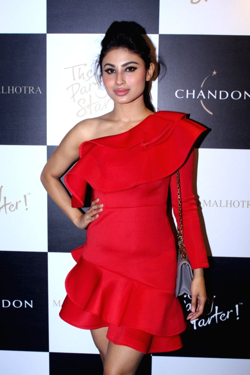 Mouni Roy dresed like the petals of a red rose