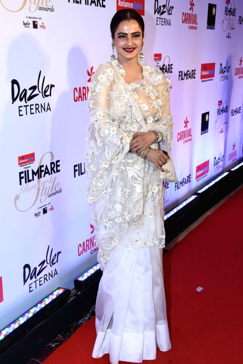 Rekha looks elegant in a white lacy saree with floral detailing