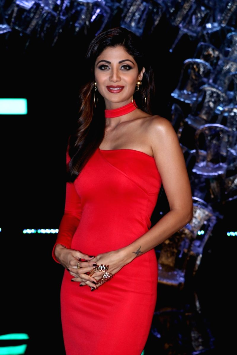 Shilpa Shetty surely turned some heads in the room in this off shoulder red dress