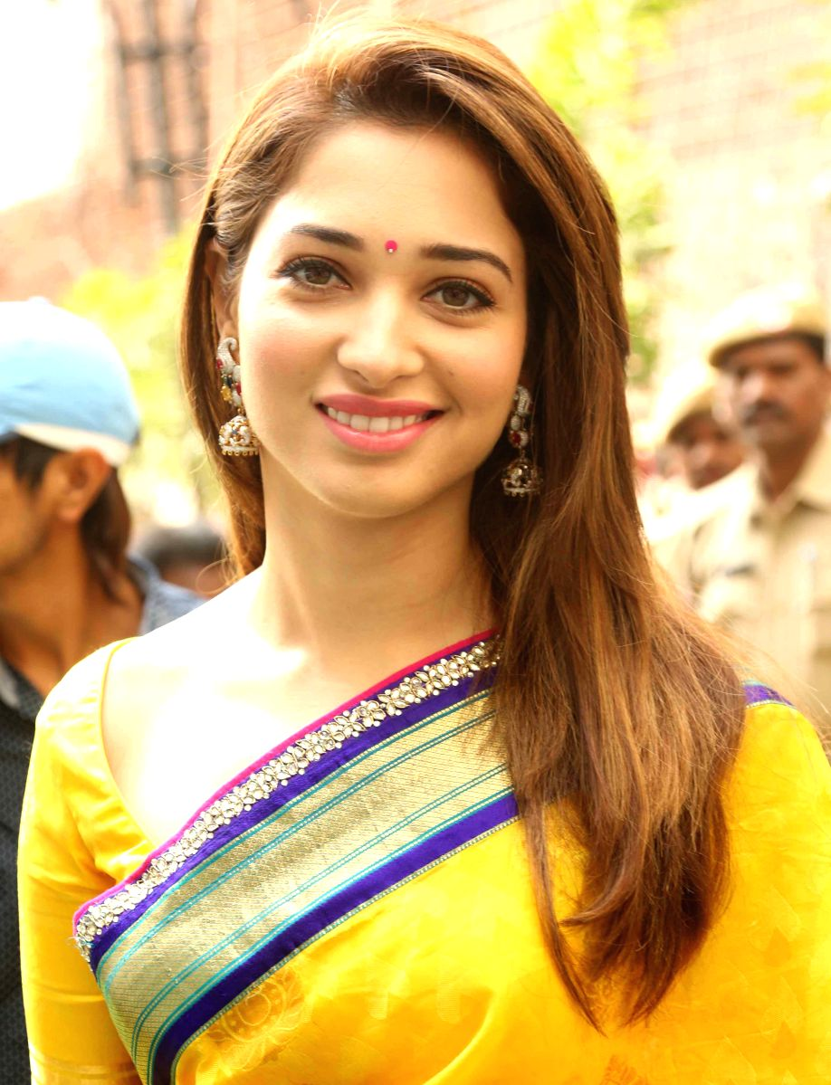 Tamannaah looks like the morning sun in this bright yellow saree and traditional Bhindi with some lovely Jhumkas