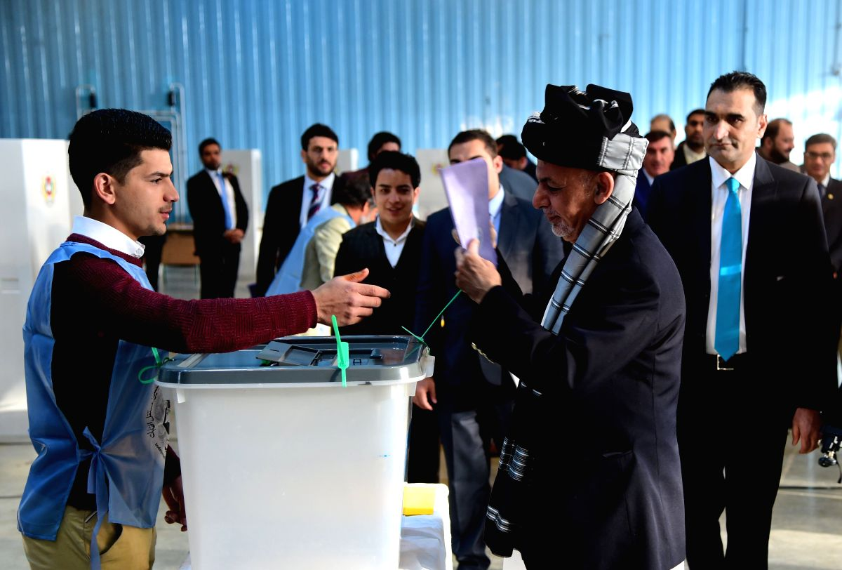 :Afghan President Ashraf Ghani (R, front) casts his ballot at a polling center during parliamentary elections in Kabul, Afghanistan, Oct. 20, 2018. Millions of ...