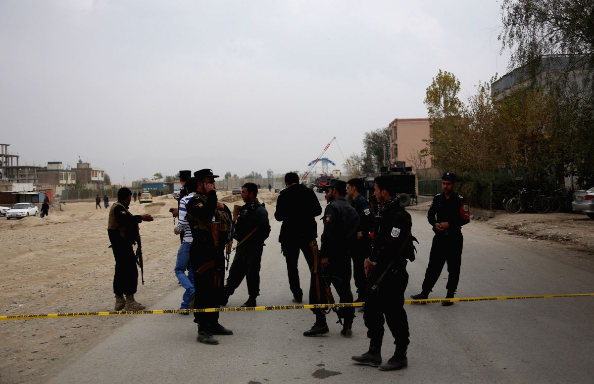 :Afghan security force members inspect at the site of a suicide attack in Kabul, capital of Afghanistan, Oct. 31, 2018. At least seven people were killed and ...