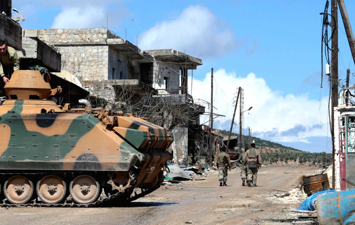 AFRIN (SYRIA), March 16, 2018 (Xinhua) -- Photo taken on March 16, 2018 shows a Turkish armored vehicle deployed near central Afrin, Syria. Turkish army has taken control of 75 percent of Afrin province in northern Syria, Turkey's President Recep Tay