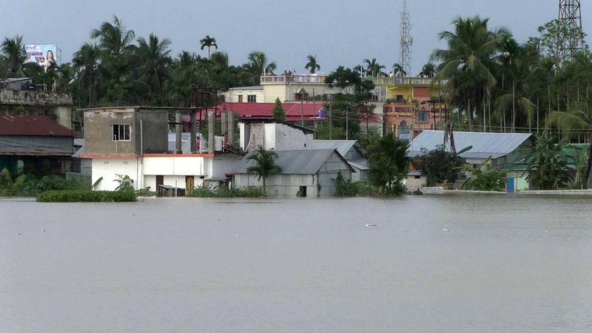 Agartala: Flood water inundates houses on the outskirts of Agartala on July 14, 2019.