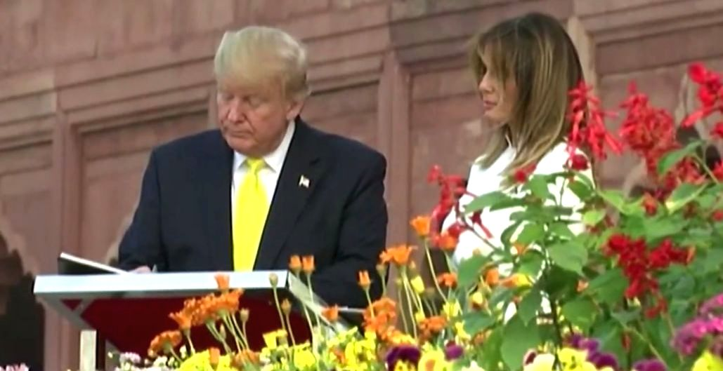Agra: US President Donald Trump accompanied by First Lady Melania Trump signs the Visitors Book during their visit to the Taj Mahal in Agra on Feb 24, 2020.