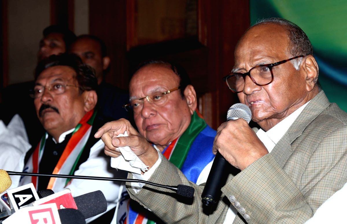 Ahmedabad: Nationalist Congress Party (NCP) President Sharad Pawar addresses a press conference after Former Gujarat Chief Minister Shankersinh Vaghela (C) joined the party in Ahmedabad, on Jan 29, 2019.