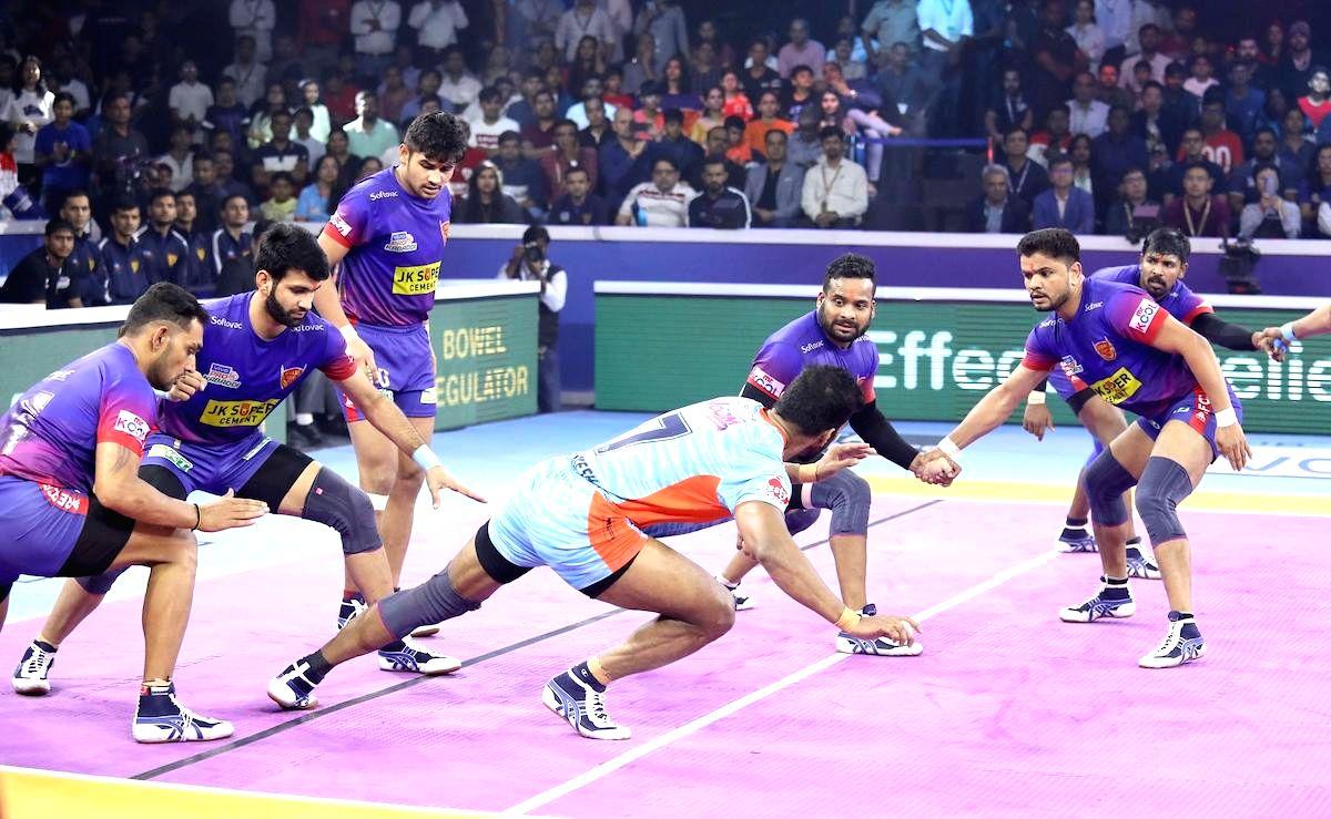 Ahmedabad: Players in action during Pro Kabaddi Season 7 final match between Dabang Delhi and Bengal Warriors in Ahmedabad on Oct 19, 2019.