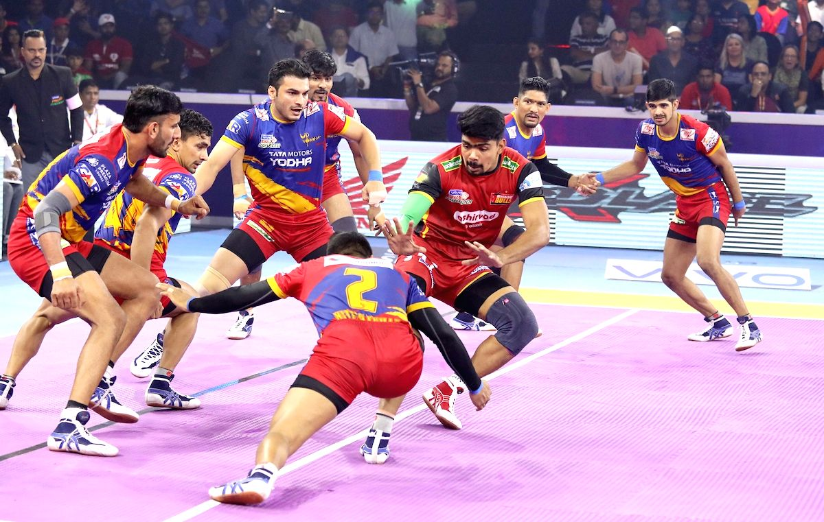 Ahmedabad: Players in action during Pro Kabaddi Season 7 Playoffs Eliminator 1 match between UP Yoddha and Bengaluru Bulls at the EKA Arena by TransStadia in Ahmedabad on Oct 14, 2019.
