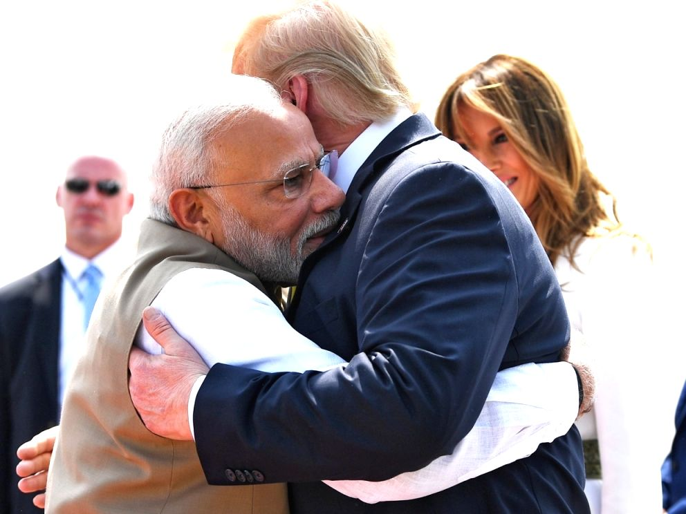 Ahmedabad: Prime Minister Narendra Modi greets US President Donald Trump with a hug on his arrival at the Sardar Vallabhbhai Patel International Airport in Ahmedabad on Feb 24, 2020. A red carpet welcome was given to Trump and First Lady Melania Trum