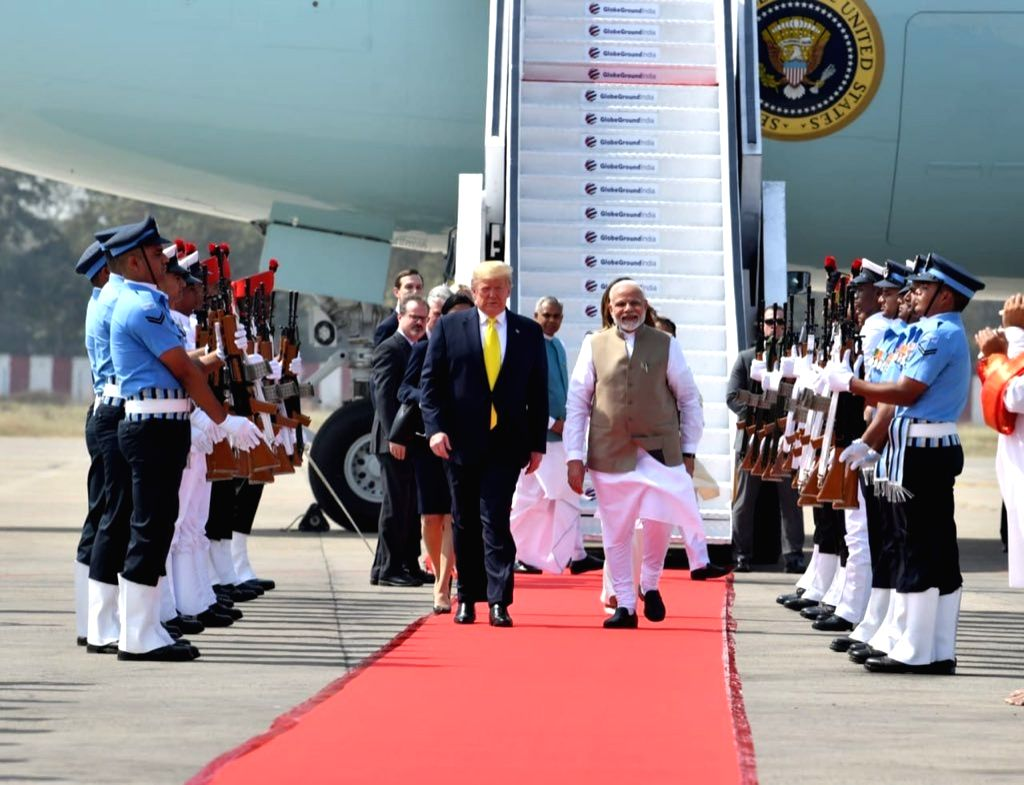 Ahmedabad: Prime Minister Narendra Modi receives US President Donald Trump and First Lady Melania Trump on their arrival at the Sardar Vallabhbhai Patel International Airport in Ahmedabad on Feb 24, 2020. A red carpet welcome was given to Trump and M