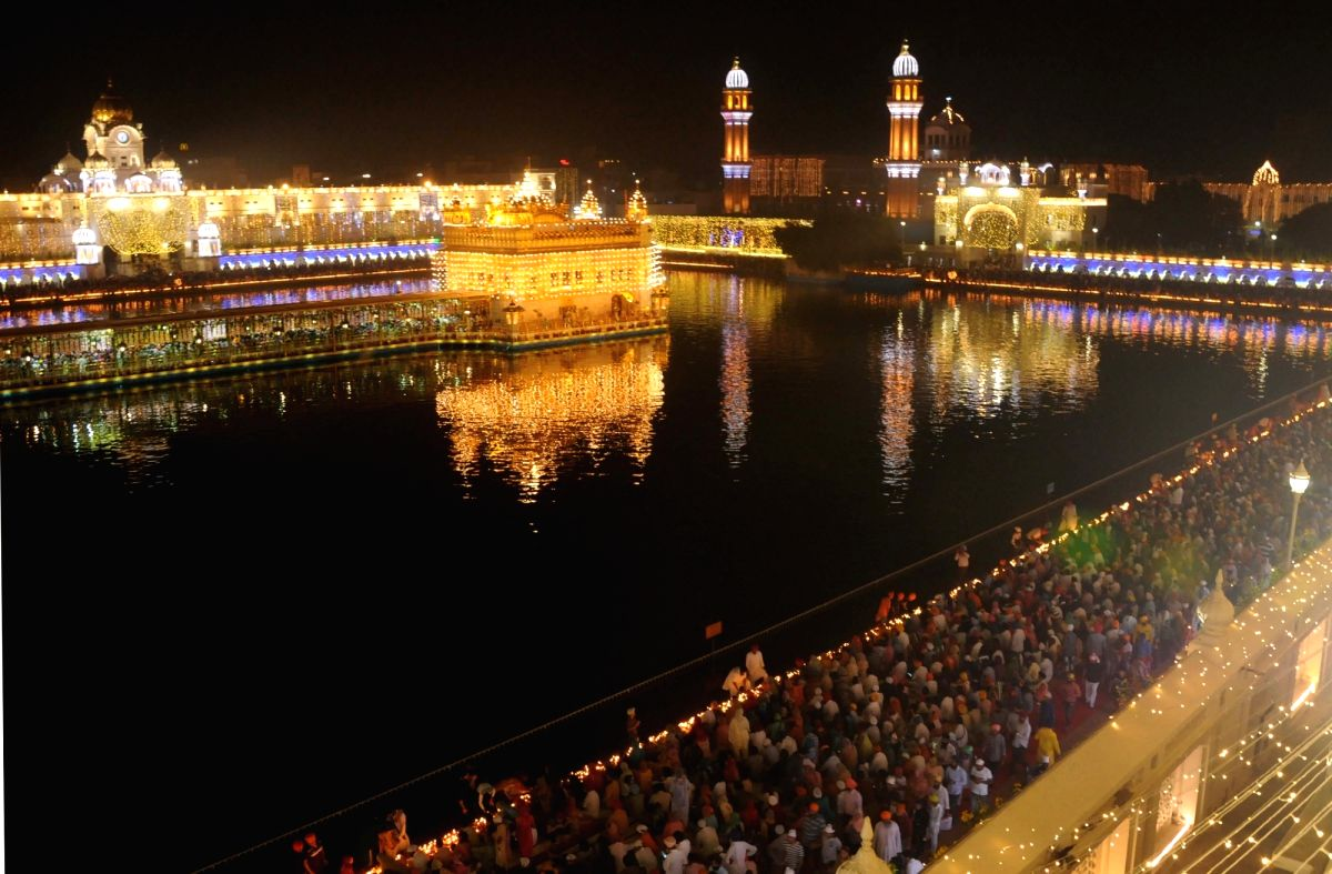 Amritsar: A view of illuminated Golden Temple on the occasion of 485th birth anniversary of the fourth Sikh Guru Ramdas Ji in Amritsar on Oct 15, 2019.
