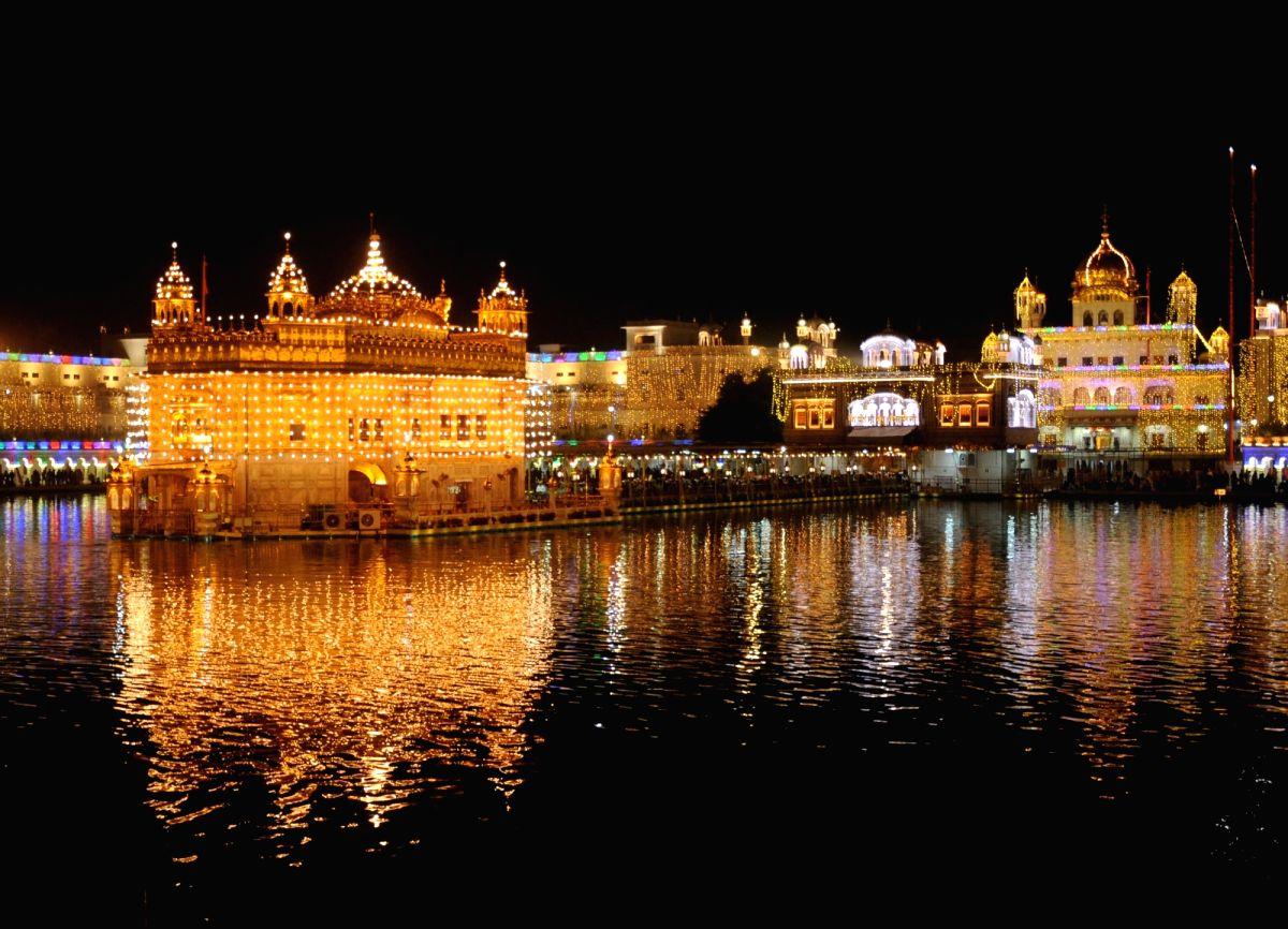 Amritsar: Golden Temple illuminated on the eve of the 550th birth anniversary of Guru Nanak Dev, in Amritsar on Nov 11, 2019.