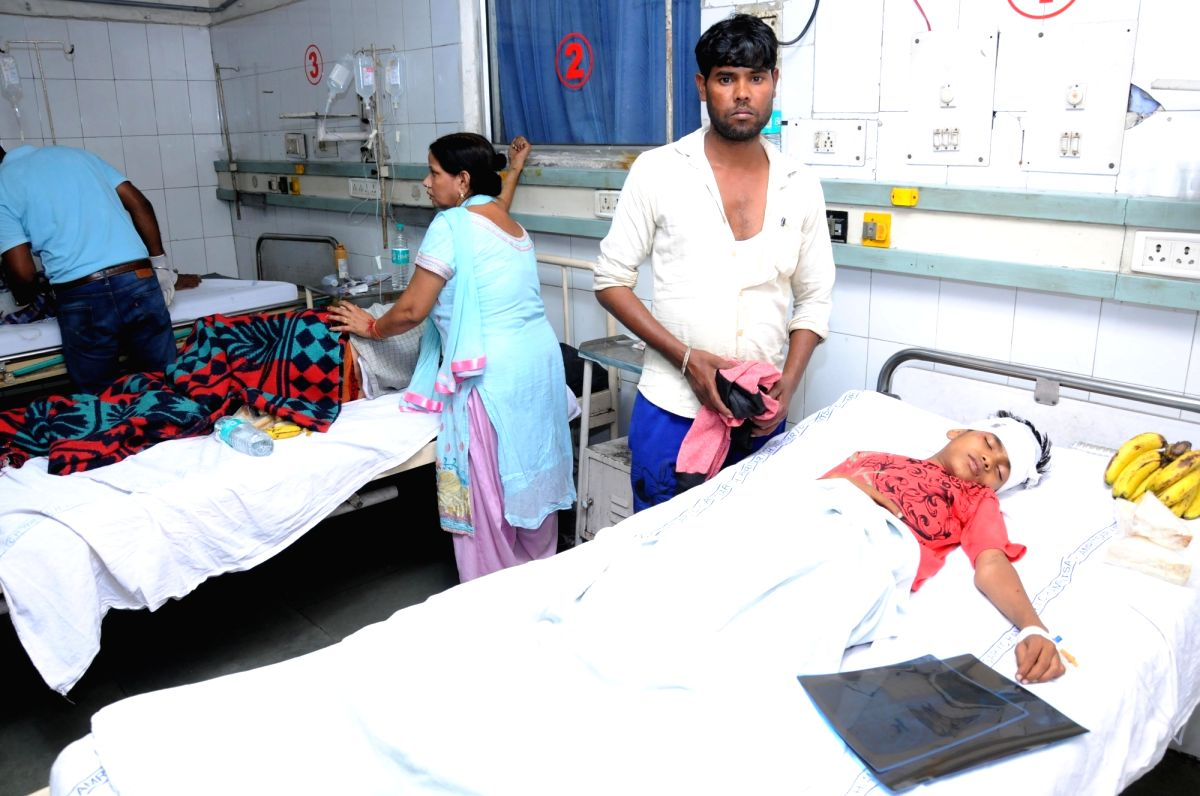 :Amritsar: One of the persons injured after a speeding train mowed down at least 50 Dussehra revellers being treated at an Amritsar hospital on Oct 19, 2018. .