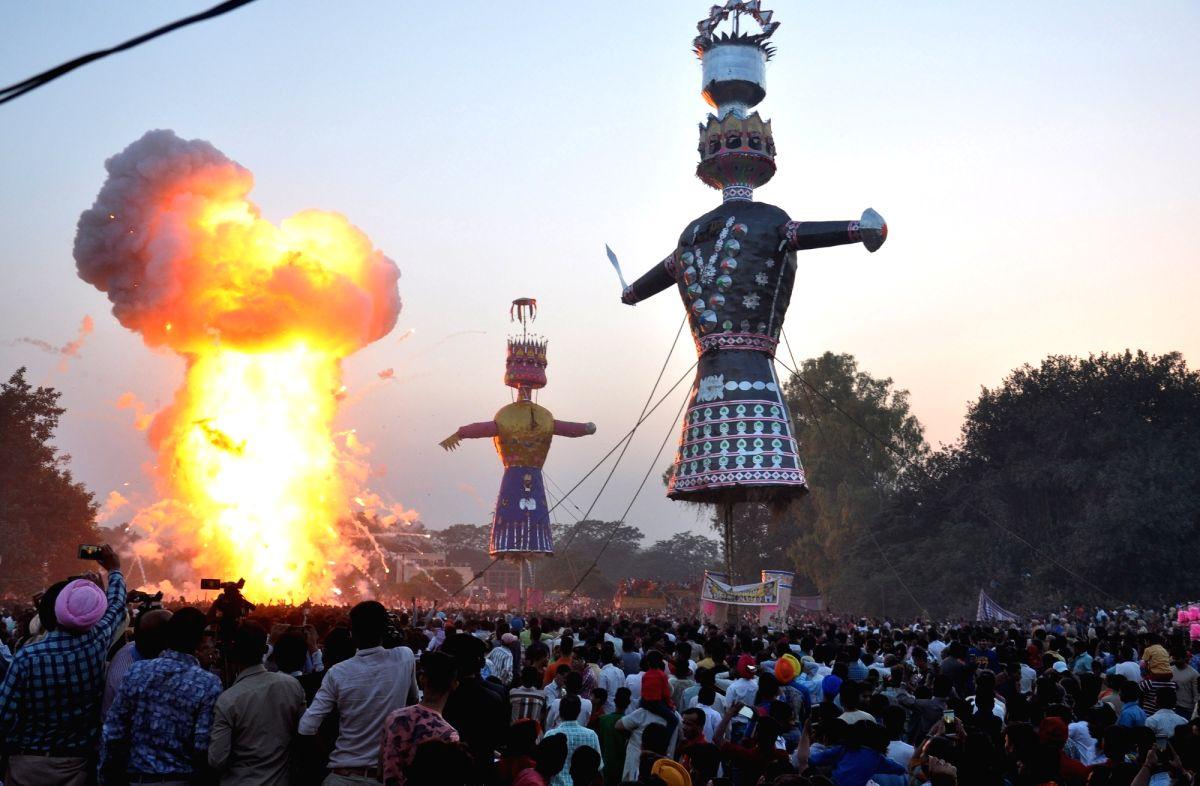 :Amritsar: Spectators gather to witness burning of effigies of Ravana, Kumbhakarana and Meghnath on Dussehra in Amritsar on Oct 19, 2018. .