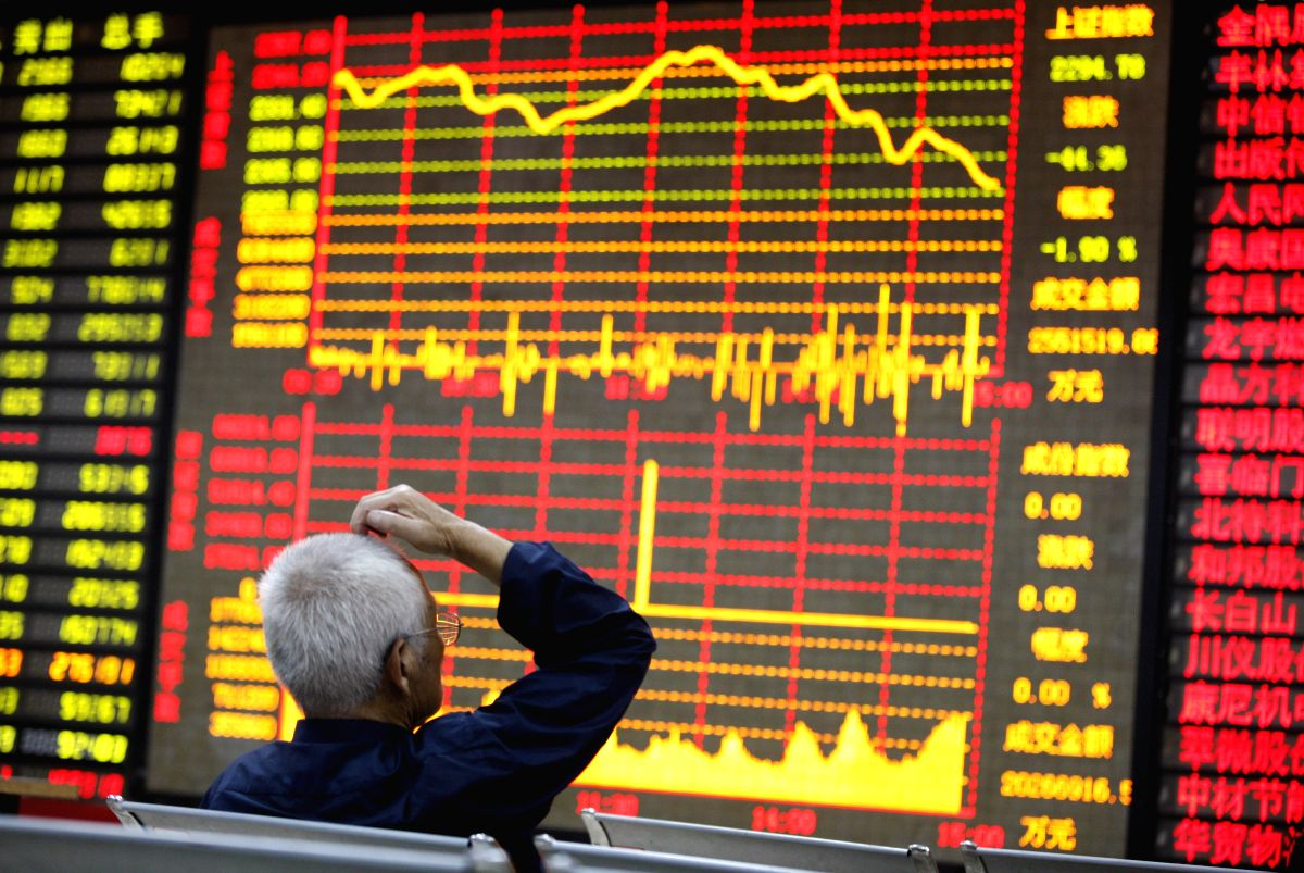 An investor in the trading hall of a Chinese securities firm in China's Huaibei City. (File Photo: Xinhua/Xie Zhengyi/IANS)