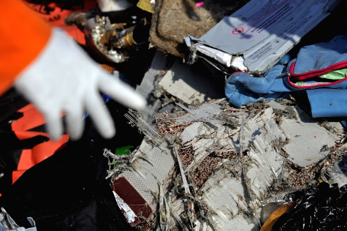 An officer of the Search and Rescue shows the debris of the Lion Air plane found