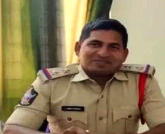 Andhra police officer's daredevil chase on car bonnet.