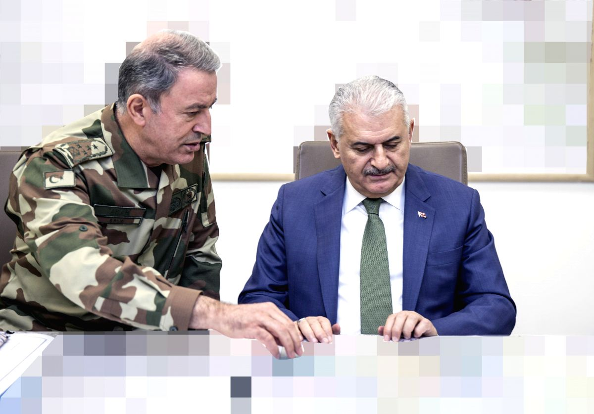 ANKARA, Jan. 20, 2018 (Xinhua) -- Turkish Prime Minister Binali Yildirim (R) meets with Turkish Chief of General Staff Gen. Hulusi Akar at the Turkish Armed Forces' headquarters in Ankara, Turkey, Jan. 20, 2018. Turkish Prime Minister Binali Yildirim
