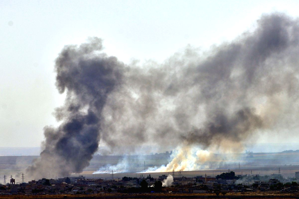 ANKARA, Oct. 13, 2019 (Xinhua) -- Photo taken from southern Turkish border town of Ceylanpinar on Oct. 12, 2019 shows smoke rising from the northern Syrian city of Ras al-Ain during an attack launched by Turkish army. Turkish President Recep Tayyip E